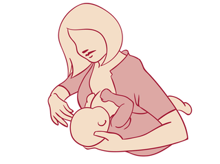 mother holding baby on forearm while breastfeeding