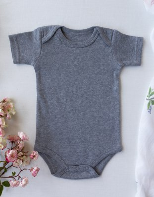 baby bodysuit with envelope folds on the left and right shoulder