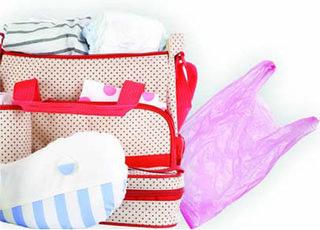 a nappy bag and a plastic bag